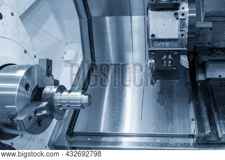 The  Cnc Lathe Machine Forming Cutting At The Metal  Shape Parts. The Hi-technology Metal Working Pr