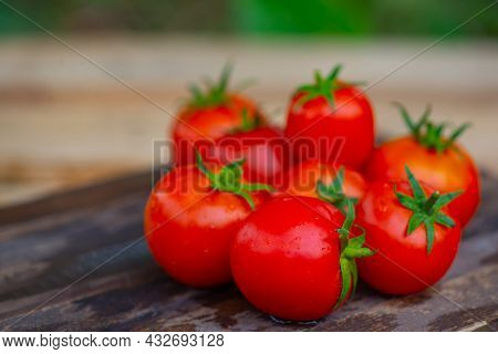 Summer Cottage Tomatoes Lie On A Wooden Background