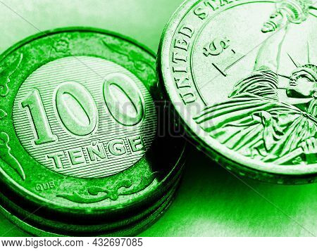 Kazakh Tenge And Us Dollar. Green Tinted Illustration About The Exchange Rate Of Currencies And The
