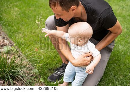 Portrait Of Young Handsome Father Holding His Adorable Cute Newborn Baby Boy. Lifestyle. Real People