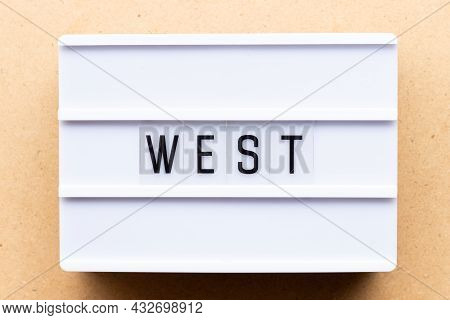 Lightbox With Word West On Wood Background