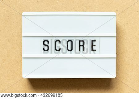 Lightbox With Word Score On Wood Background