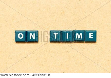 Tile Alphabet Letter In Word On Time On Wood Background