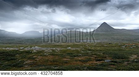 Epic Panorama View Of Mt Slugga In Swedish Lapland On A Very Cloudy Day Of Arctic Summer. Dramatic W