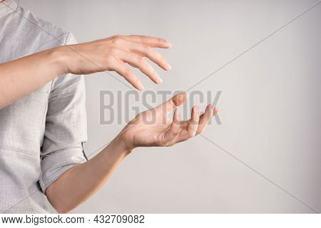 Two Womens Hands Are Holding Something In Their Palms,