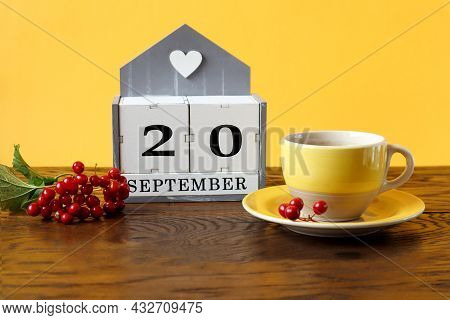 Calendar For September 20 : The Name Of The Month In English, Cubes With The Number 20, A Yellow Cup