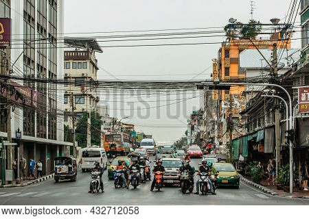 Bangkok, Thailand - January 17,2020.busy Street In Chinatown,junction With Cars,buses,motorbikes,peo
