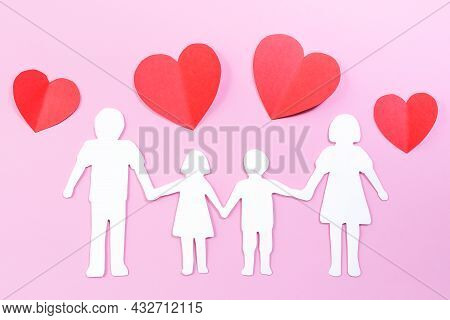 Paper Family Cut Out On Bright Pink Background With Paper Hearts. Family Home, Foster Care, Family M
