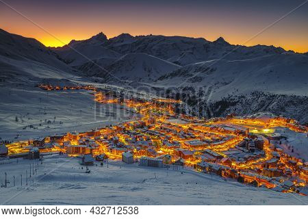 Famous Winter Ski Resort And Cityscape At Dawn. Popular Destination And Ski Slopes At Sunrise, Alpe