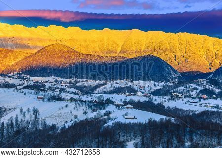 Magical Winter Dawn Landscape With Spectaular Snowy Mountains. Breathtaking Sunrise And Snowy Mounta