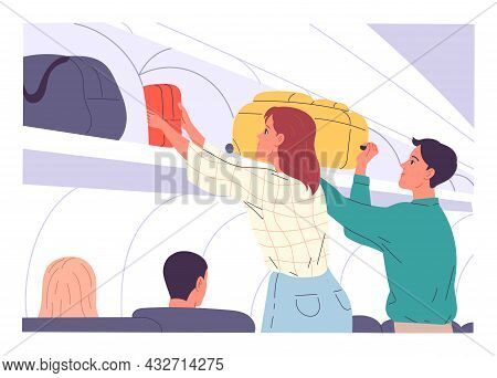 Passengers Putting Their Hand Luggage Into Overhead Locker On Aircraft.