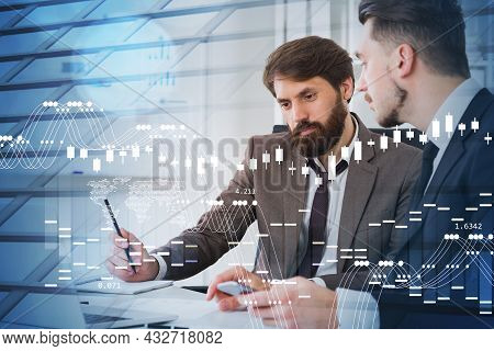 Two Businessmen Wearing Formal Suits Are Working Together Looking At Laptop. Office Workplace With S