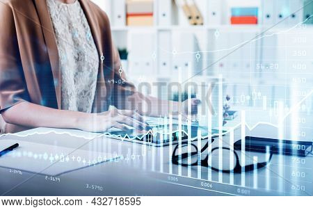 Businesswoman Wearing Brown Dress Is Touching Screen Of Tablet. Office Workplace With Notebook In Th