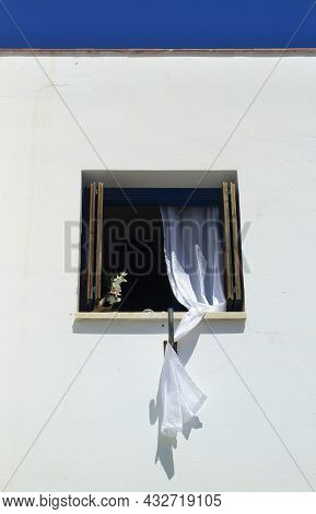 Window With White Curtains On White Facade In Almeria, Spain