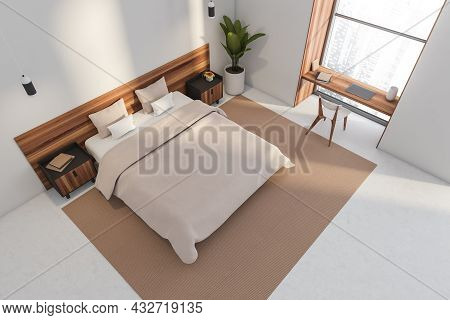 Top View Of A Bed In A White Bedroom Interior With A Desk And A Chair In A Niche Window, Two Pendant