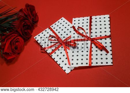 3 red roses  bouquet with gift envelope, red ribbons, white paper for certificates, invitation card