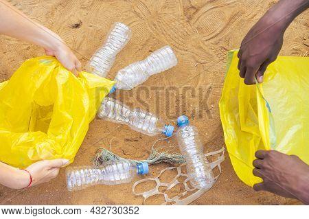 Hands Picked Plastic Bottle Waste On Beach,garbage Is On Beach. Volunteer People Collecting Trash On