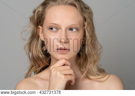 Close Up Of Beauty Woman Face Portrait With Blue Eyes And Curly Hair. Spa Model Girl With Perfect Fr