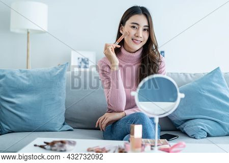 Portrait Of Beautiful Woman Artist Stay Home, Enjoying Makeup Herself. Young Attractive Girl Sit On