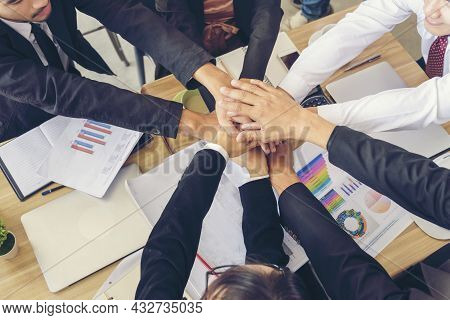 Partners Hands Together Teamwork Group Of Business People Meeting In Firm Company Office. Diversity