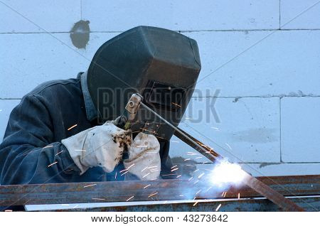 welder worker welding metal