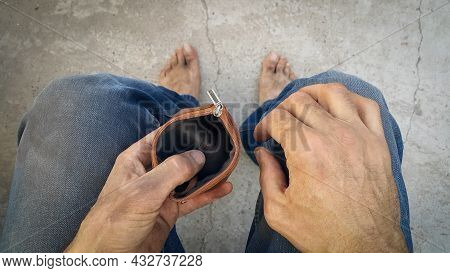 The Dirty Hands Of A Homeless Poor Man With An Empty Wallet. An Unemployed Man. Bankruptcy Of The En