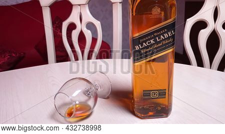 Bottle Of Johnnie Walker Black Label Blended Scotch Whisky On Table In Room. Perm, Russia, 29 August