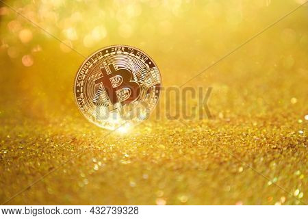 One Bitcoin Coin. The Bitcoin Cryptocurrency Is The Coin Of The Future. Golden Bitcoin. Golden Shiny