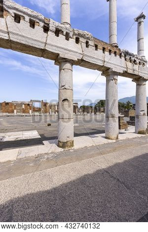Pompeii, Naples, Italy - June 26, 2021: The Forum Of Pompeii With The Entrance To The Basilica. Ruin