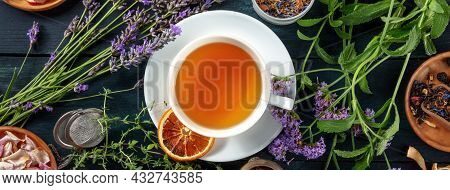 Tea Panorama With Herbs, Flowers And Fruit, Shot From The Top On A Dark Rustic Wooden Background