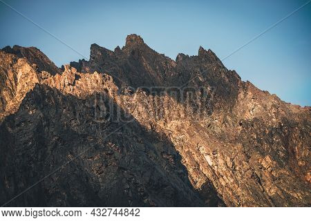 Scenic Mountain Landscape With Great Rocks In Golden Sunlight. Awesome Rocky Wall With Sharp Top In