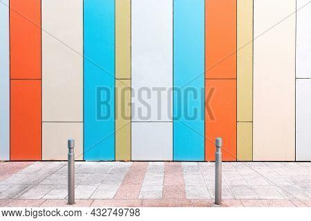 Modern Urban Scene With Empty Street And Colorful Geometrical Wall. Creative Modern Urban City Backg