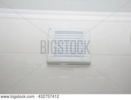 A Close-up Of A Bathroom Vent Fan, Exhaust Fan, Bathroom Ventilation With White Grill Installed On A