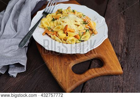 Pasta With Organic Chanterelles. Portion Of Pasta With Fried Chanterelles In A Creamy Garlic Sauce W
