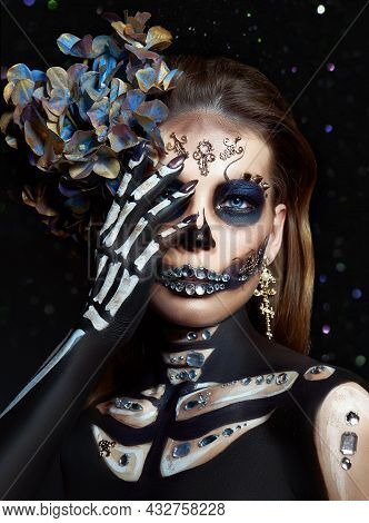 Halloween Beauty Portrait Of A Skeleton Woman Of Death Bokeh Glitter, The Makeup On The Face. Girl D