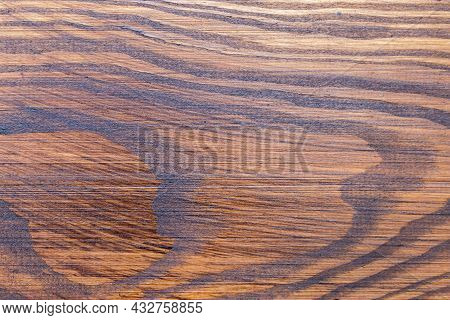 Fragment Of Roughly Handled Pine Plank Covered With Mordant Close-up, Texture, Background
