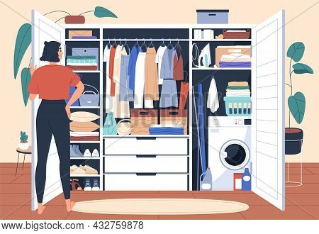 Wardrobe After Decluttering And Putting In Order. Woman In Front Of Tidy Closet With Organized Arran
