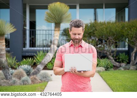 Man Real Estate, Rental House. Portrait Of Confident Man Standing Outside New Home. Successful Real