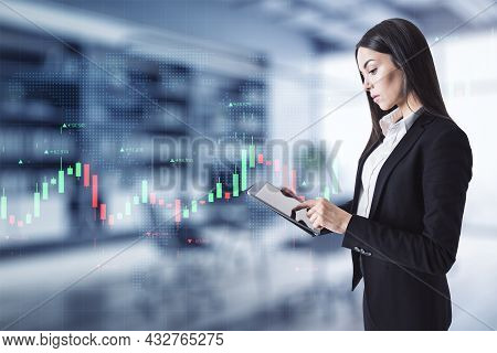 Attractive Young European Businesswoman With Tablet Using Creative Glowing Forex Chart Interface In