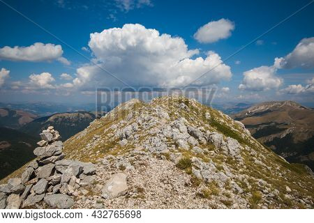 A Pile Of Stones (also Called Cairn, Steinmännchen Or Steinmandl) In The Peak Of Italian Apennines W