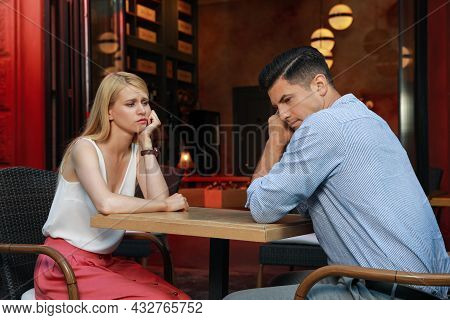 Bored Couple Having Unsuccessful Date In Cafe