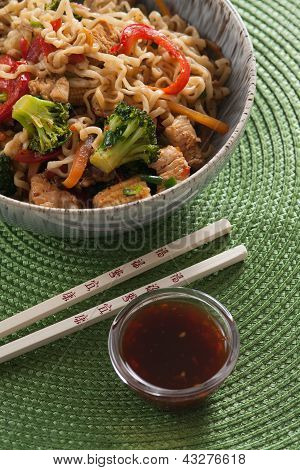 Egg Noodle Wok With Chopsticks And Sauce On Green Background