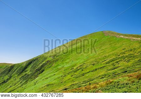 Beautiful, Summer Slopes Of Mountains Covered With Green Young Grass Against The Blue Sky, Travel. H