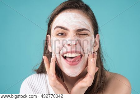 Woman Facial Mask With Fun, Face Clay. Funny Woman With Cosmetic Facial Procedure, Spa Skin Concept.