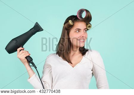 Woman With Hair Dryer. Beautiful Girl With Straight Hair Drying Hair With Professional Hairdryer. Is