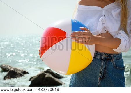Young Woman With Inflatable Beach Ball Near Sea On Sunny Day, Closeup