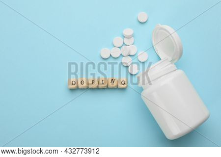 Wooden Cubes With Word Doping And Drugs On Turquoise Background, Flat Lay