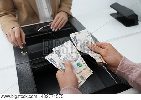 Man With Money At Cash Department Window, Closeup. Currency Exchange