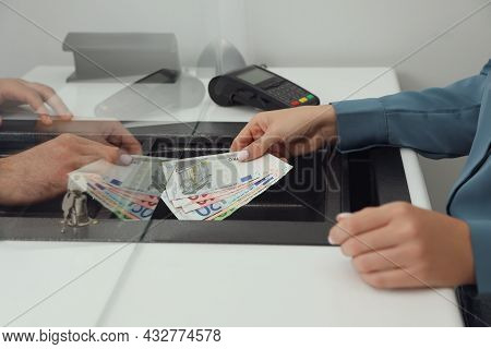 Woman Giving Money To Cashier In Bank, Closeup. Currency Exchange
