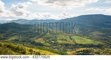 Carpathian Countryside Landscape In Early Autumn. Beautiful Mountain Landscape In Dappled Light. War